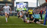 18 January 2020; Will Addison of Ulster dives to score his side's third try despite the tackle from Gabe Hamer-Webb of Bath during the Heineken Champions Cup Pool 3 Round 6 match between Ulster and Bath at Kingspan Stadium in Belfast. Photo by Oliver McVeigh/Sportsfile