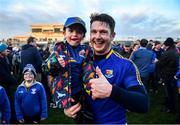 18 January 2020; Longford captain Michael Quinn celebrates with supporter Fionn Coy following the 2020 O'Byrne Cup Final between Offaly and Longford at Bord na Mona O'Connor Park in Tullamore, Offaly. Photo by David Fitzgerald/Sportsfile