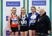 18 January 2020; Athletics Ireland President Georgina Drumm, right, with  U15 Women's combined events medallists, from left, Ashleigh Mcardle of Lifford Strabane A.C., Co. Donegal, silver, Hannah Falvey of Belgooly A.C., Co. Cork, gold, and Cara O'Sullivan of Ratoath A.C., Co. Meath, bronze,  during the Irish Life Health Indoor Combined Events All Ages at Athlone International Arena, AIT in Athlone, Co. Westmeath. Photo by Sam Barnes/Sportsfile