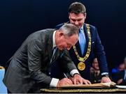 18 January 2020; Former Dublin GAA football team manager Jim Gavin signs the Roll of Honour, as Lord Mayor of Dublin Paul McAuliffe looks on, at the Conferring of the Honorary Freedom of Dublin City on Jim Gavin ceremony in the Round Room at the Mansion House, in Dawson St, Dublin. Photo by Ray McManus/Sportsfile