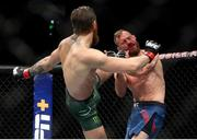 18 January 2020; Conor McGregor lands a kick on Donald Cerrone during their UFC 246 Welterweight bout at the T-Mobile Arena in Las Vegas, Nevada, USA. Photo by Mark J. Rebilas / USA TODAY Sports via Sportsfile