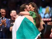 18 January 2020; Conor McGregor celebrates with partner Dee Devlin following his UFC 246 Welterweight bout victory over Donald Cerrone at the T-Mobile Arena in Las Vegas, Nevada, USA. Photo by Mark J. Rebilas / USA TODAY Sports via Sportsfile