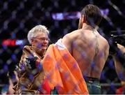 18 January 2020; Jerry Cerrone, grandmother of Donald Cerrone meets with Conor McGregor following his UFC 246 Welterweight bout victory over Donald Cerrone at the T-Mobile Arena in Las Vegas, Nevada, USA. Photo by Mark J. Rebilas / USA TODAY Sports via Sportsfile