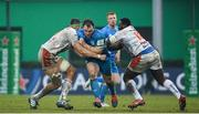 18 January 2020; Peter Dooley of Leinster is tackled by Eli Snyman, left, and Cherif Traore of Benetton during the Heineken Champions Cup Pool 1 Round 6 match between Benetton and Leinster at the Stadio Comunale di Monigo in Treviso, Italy. Photo by Ramsey Cardy/Sportsfile