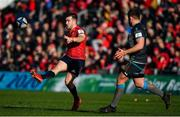 19 January 2020; JJ Hanrahan of Munster kicks past Scott Otten of Ospreys during the Heineken Champions Cup Pool 4 Round 6 match between Munster and Ospreys at Thomond Park in Limerick. Photo by Brendan Moran/Sportsfile