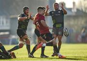 19 January 2020; Conor Murray of Munster kicks upfield under pressure from Dan Lydiate and Nicky Smith of Ospreys during the Heineken Champions Cup Pool 4 Round 6 match between Munster and Ospreys at Thomond Park in Limerick. Photo by Diarmuid Greene/Sportsfile