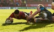 19 January 2020; Conor Murray of Munster scores his side's third try despite the efforts of Dan Baker of Ospreys during the Heineken Champions Cup Pool 4 Round 6 match between Munster and Ospreys at Thomond Park in Limerick. Photo by Diarmuid Greene/Sportsfile