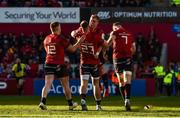 19 January 2020; Craig Casey of Munster celebrates with team-mates Rory Scannell, Dan Goggin and Jack O'Donoghue after scoring his side's fourth try during the Heineken Champions Cup Pool 4 Round 6 match between Munster and Ospreys at Thomond Park in Limerick. Photo by Diarmuid Greene/Sportsfile