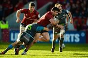19 January 2020; Sam Arnold of Munster is tackled by Cai Evans uring the Heineken Champions Cup Pool 4 Round 6 match between Munster and Ospreys at Thomond Park in Limerick. Photo by Diarmuid Greene/Sportsfile