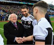 19 January 2020; President of Ireland Michael D Higgins is introduced to Kilcoo players by their captain Aidan Branagan prior to the AIB GAA Football All-Ireland Senior Club Championship Final between Corofin and Kilcoo at Croke Park in Dublin. Photo by Seb Daly/Sportsfile