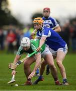 5 January 2020; Derek McNicholas of Westmeath in action against Ciaran Comerford of Laois during the 2020 Walsh Cup Round 1 match between Laois and Westmeath at O'Keeffe Park in Borris in Ossory, Laois. Photo by Ramsey Cardy/Sportsfile