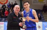 21 January 2020; St Flannan's College captain Kevin Nugent is presented with the cup by PJ Reidy of the Post Primary Schools Executive of Basketball Ireland after the Basketball Ireland U19 C Boys Schools Cup Final match between Ballymakenny College and St Flannan's College, Ennis at the National Basketball Arena in Tallaght, Dublin. Photo by Brendan Moran/Sportsfile