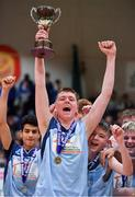 21 January 2020; Castletroy College captain Ruairi Cronin lifts the cup after the Basketball Ireland U16 B Boys Schools Cup Final match between Coláiste Cholmcille, Ballyshannon and Castletroy College at the National Basketball Arena in Tallaght, Dublin. Photo by Brendan Moran/Sportsfile
