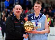 21 January 2020; Castletroy College captain Ruairi Cronin is presented with the MVP by PJ Reidy of the Post Primary Schools Committee of Basketball Ireland after the Basketball Ireland U16 B Boys Schools Cup Final match between Coláiste Cholmcille, Ballyshannon and Castletroy College at the National Basketball Arena in Tallaght, Dublin. Photo by Brendan Moran/Sportsfile