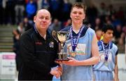 21 January 2020; Castletroy College captain Ruairi Cronin is presented with the cup by PJ Reidy of the Post Primary Schools Committee of Basketball Ireland after the Basketball Ireland U16 B Boys Schools Cup Final match between Coláiste Cholmcille, Ballyshannon and Castletroy College at the National Basketball Arena in Tallaght, Dublin. Photo by Brendan Moran/Sportsfile