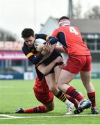 21 January 2020; David Brennan of The Kings Hospital is tackled by Callum Clinton, left, and Martin Healy of CUS during the Bank of Ireland Vinnie Murray Cup Semi-Final match between The King's Hospital and CUS at Energia Park in Dublin. Photo by Sam Barnes/Sportsfile