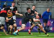 21 January 2020; Patrick Kiernan of Temple Carrig School goes over to score his side's third try despite the efforts of Jack Farrelly of The High School  during the Bank of Ireland Vinnie Murray Cup Semi-Final match between Temple Carrig School and The High School at Energia Park in Dublin. Photo by Sam Barnes/Sportsfile