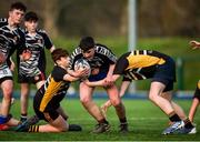 22 January 2020; Niall O'Hanlon of Ardscoil na Trionoide is tackled by Max McKenna, left, and Matthew Clinton of St. Patrick's Classical School during the Bank of Ireland Father Godfrey Cup Quarter-Final match between Ardscoil na Trionoide and St. Patrick's Classical School at Energia Park in Donnybrook, Dublin. Photo by Ben McShane/Sportsfile