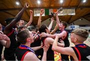 22 January 2020; St Eunan's College, Letterkenny captain Luke Cassidy lifts the trophy and celebrates with team-mates following the Basketball Ireland U19 B Boys Schools Cup Final match between St Eunan's College, Letterkenny and Waterpark College at the National Basketball Arena in Tallaght, Dublin. Photo by David Fitzgerald/Sportsfile