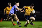22 January 2020; David Garland of DCU Dóchas Éireann in action against Martin O'Connor of UCD during the Sigerson Cup Semi-Final match between DCU Dóchas Éireann and UCD at Dublin City University Sportsgrounds in Glasnevin, Dublin. Photo by Ben McShane/Sportsfile