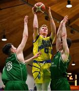 25 January 2020; Eoin McCann of UCD Marian in action against James Cummins, left, and James Lyons of Moycullen during the Hula Hoops U20 Men's National Cup Final between Moycullen and UCD Marian at the National Basketball Arena in Tallaght, Dublin. Photo by Brendan Moran/Sportsfile