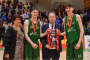 25 January 2020; Moycullen co-captains James Lyons, left, and Dara Kenna are presented with the cup by Joe Naughton, Chairperson, Galway Area Board of Basketball Ireland, in the company of Basketball Ireland President Theresa Walsh, after the Hula Hoops U20 Men's National Cup Final between Moycullen and UCD Marian at the National Basketball Arena in Tallaght, Dublin. Photo by Brendan Moran/Sportsfile