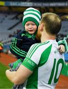 25 January 2020; Three year old Fionn O'Connor with his dad, Dan, after the AIB GAA Football All-Ireland Junior Club Championship Final match between Na Gaeil and Rathgarogue-Cushinstown at Croke Park in Dublin. Photo by Ray McManus/Sportsfile