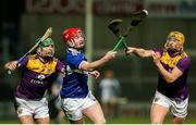 25 January 2020; Aaron Bergin of Laois in action against Damien Reck and Shaun Murphy of Wexford during the Allianz Hurling League Division 1 Group B Round 1 match between Laois and Wexford at MW Hire O'Moore Park in Portlaoise, Co Laois. Photo by Michael P Ryan/Sportsfile