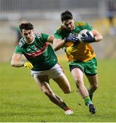 25 January 2020; Ryan McHugh of Donegal in action against Oisin Mullin of Mayo during the Allianz Football League Division 1 Round 1 match between Donegal and Mayo at MacCumhaill Park in Ballybofey, Donegal. Photo by Oliver McVeigh/Sportsfile