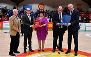 25 January 2020; Secretary General of FIBA World Andreas Zagklis makes a presentation to Basketball Ireland President Theresa Walsh and Secretary General of FIBA Europe Kamil Novak makes a presentation to Basketball Ireland Secretary General Bernard O'Byrne, in the company of Sport Ireland CEO John Treacy, left, during the Hula Hoops Pat Duffy National Cup Final between DBS Éanna and Griffith College Templeogue at the National Basketball Arena in Tallaght, Dublin. Photo by Brendan Moran/Sportsfile