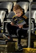 26 January 2020; Eight year old Robbie Atkins English reads his programme before the Allianz Hurling League Division 1 Group B Round 1 match between Kilkenny and Dublin at UPMC Nowlan Park in Kilkenny. Photo by Ray McManus/Sportsfile