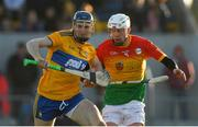 26 January 2020; David Fitzgerald of Clare in action against Kevin McDonald of Carlow during the Allianz Hurling League Division 1 Group B Round 1 match between Clare and Carlow at Cusack Park in Ennis, Clare. Photo by Diarmuid Greene/Sportsfile