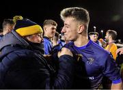 29 January 2020; Evan Comerford of DCU Dóchas Éireann, right, is congratulated by logistics manager Krzysztof Jendrulok following their side's victory of the Sigerson Cup Final match between DCU Dóchas Éireann and IT Carlow at Dublin City University Sportsgrounds in Glasnevin, Dublin. Photo by Seb Daly/Sportsfile