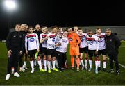 30 January 2020; Dundalk players and supporter Cillian Malone celebrate with the trophy following the Jim Malone Cup match between Dundalk and Drogheda United at Oriel Park in Dundalk, Co Louth. Photo by Harry Murphy/Sportsfile