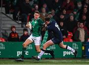 31 January 2020; Jack Crowley of Ireland avoids the tackle of Ollie Smith of Scotland on his way to scoring his side's third try during the U20 Six Nations Rugby Championship match between Ireland and Scotland at Irish Independent Park in Cork. Photo by Harry Murphy/Sportsfile