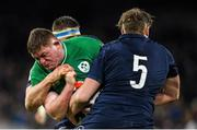 1 February 2020; Tadhg Furlong of Ireland is tackled by Nick Haining and Jonny Gray, 5, of Scotland during the Guinness Six Nations Rugby Championship match between Ireland and Scotland at the Aviva Stadium in Dublin. Photo by Ramsey Cardy/Sportsfile