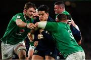 1 February 2020; Sam Johnson of Scotland is tackled by Tadhg Furlong, right, and Iain Henderson of Ireland during the Guinness Six Nations Rugby Championship match between Ireland and Scotland at the Aviva Stadium in Dublin. Photo by Brendan Moran/Sportsfile