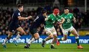 1 February 2020; Josh van der Flier with the support of his Ireland team-mate Robbie Henshaw, right, is tackled by Sam Johnson of Scotland during the Guinness Six Nations Rugby Championship match between Ireland and Scotland at the Aviva Stadium in Dublin. Photo by Ramsey Cardy/Sportsfile