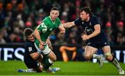 1 February 2020; John Cooney of Ireland is tackled by George Horne, left, and Hamish Watson of Scotland during the Guinness Six Nations Rugby Championship match between Ireland and Scotland at the Aviva Stadium in Dublin. Photo by Brendan Moran/Sportsfile