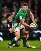 1 February 2020; John Cooney of Ireland is tackled by George Horne of Scotland during the Guinness Six Nations Rugby Championship match between Ireland and Scotland at the Aviva Stadium in Dublin. Photo by Brendan Moran/Sportsfile