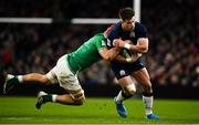1 February 2020; Huw Jones of Scotland is tackled by Josh van der Flier of Ireland during the Guinness Six Nations Rugby Championship match between Ireland and Scotland at the Aviva Stadium in Dublin. Photo by Brendan Moran/Sportsfile