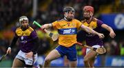 2 February 2020; Tony Kelly of Clare in action against Paul Morris and Aidan Rochford of Wexford, left, during the Allianz Hurling League Division 1 Group B Round 2 match between Wexford and Clare at Chadwicks Wexford Park in Wexford. Photo by Ray McManus/Sportsfile
