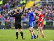 2 February 2020; Darren Hughes of Monaghan is issued a black card by referee David Gough for a foul on Peter Harte of Tyrone, right, during the Allianz Football League Division 1 Round 2 match between Monaghan and Tyrone at St. Mary's Park in Castleblayney, Monaghan. Photo by Oliver McVeigh/Sportsfile