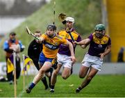 2 February 2020; Tony Kelly of Clare narrowly fails to stop the sliothar from going out over the sideline under pressure from Wexford players Conor Dunbar, 22, and Shaun Murphy during the Allianz Hurling League Division 1 Group B Round 2 match between Wexford and Clare at Chadwicks Wexford Park in Wexford. Photo by Ray McManus/Sportsfile