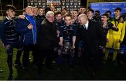 5 February 2020; Eric Whelan of DCU is presented with the Collingwood Cup by IUFU Chairman Terry McCauley, left, and FAI President Gerry McAnaney following the Rustlers IUFU Collingwood Cup Final match between DCU and Ulster University at Dalymount Park in Dublin. Photo by Sam Barnes/Sportsfile