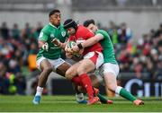 8 February 2020; Leigh Halfpenny of Wales is tackled by Bundee Aki, left, and Robbie Henshaw of Ireland during the Guinness Six Nations Rugby Championship match between Ireland and Wales at the Aviva Stadium in Dublin. Photo by Ramsey Cardy/Sportsfile