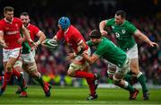 8 February 2020; Justin Tipuric of Wales is tackled by Iain Henderson of Ireland as he attempts to offload to team-mate Dan Biggar during the Guinness Six Nations Rugby Championship match between Ireland and Wales at Aviva Stadium in Dublin. Photo by Brendan Moran/Sportsfile