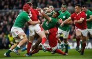 8 February 2020; Bundee Aki of Ireland is tackled by Nick Tompkins, left, and Hadleigh Parkes of Wales during the Guinness Six Nations Rugby Championship match between Ireland and Wales at the Aviva Stadium in Dublin. Photo by Ramsey Cardy/Sportsfile