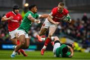 8 February 2020; Johnny McNicholl of Wales is tackled by Bundee Aki, left, and Conor Murray of Ireland during the Guinness Six Nations Rugby Championship match between Ireland and Wales at Aviva Stadium in Dublin. Photo by David Fitzgerald/Sportsfile
