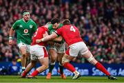 8 February 2020; Robbie Henshaw of Ireland is tackled by Dillon Lewis, left, and Jake Ball of Wales during the Guinness Six Nations Rugby Championship match between Ireland and Wales at Aviva Stadium in Dublin. Photo by Brendan Moran/Sportsfile